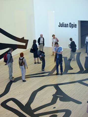 Visitors examine the artist's lines